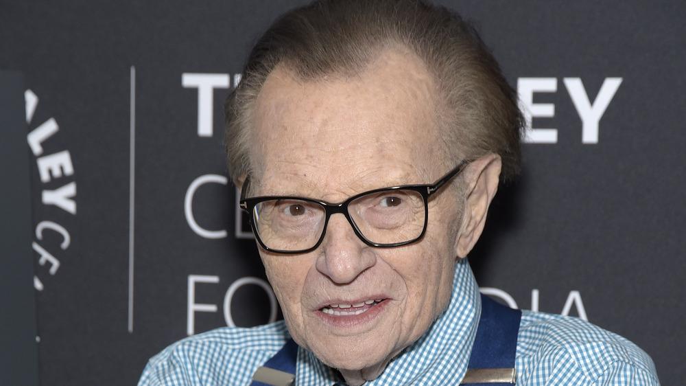 Larry King wears glasses