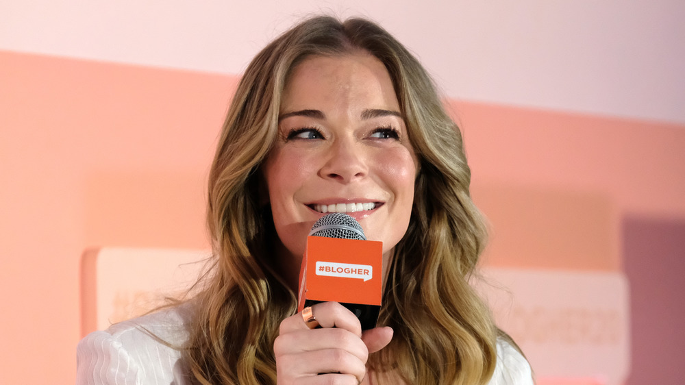 LeAnn Rimes speaking at an event.