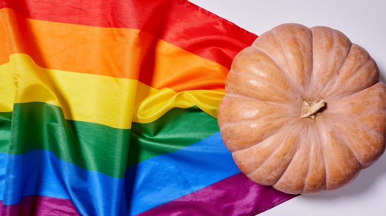 Pumpkin atop a rainbow flag