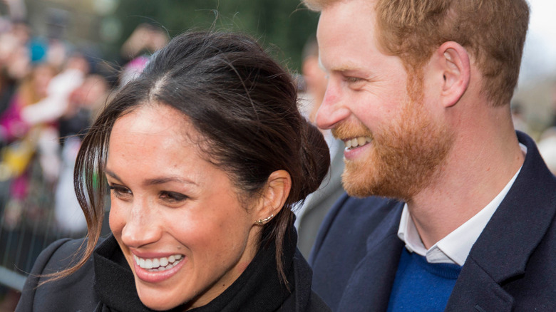 Meghan Markle standing with Prince Harry