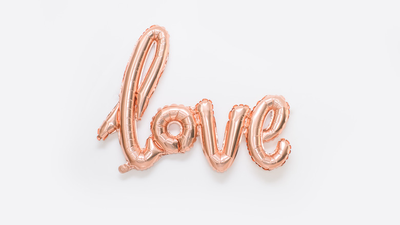 Rose gold foil balloon spelling out the word love