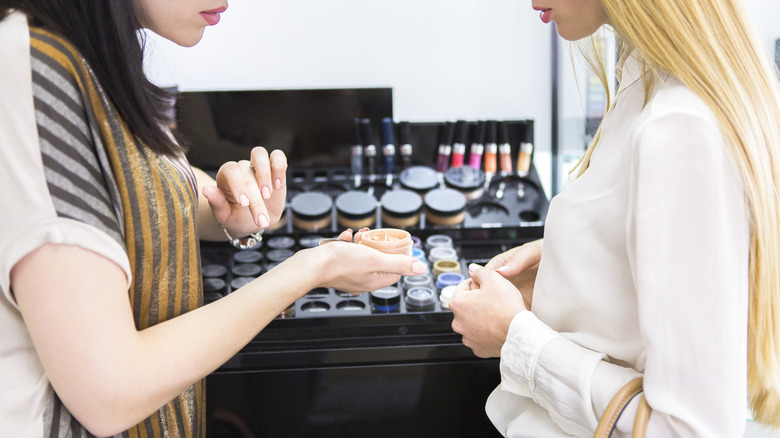 woman being shown makeup