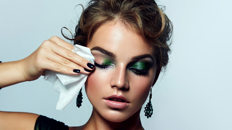 Woman taking off makeup