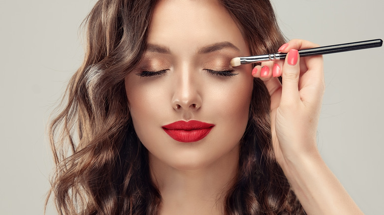 A woman having her makeup done