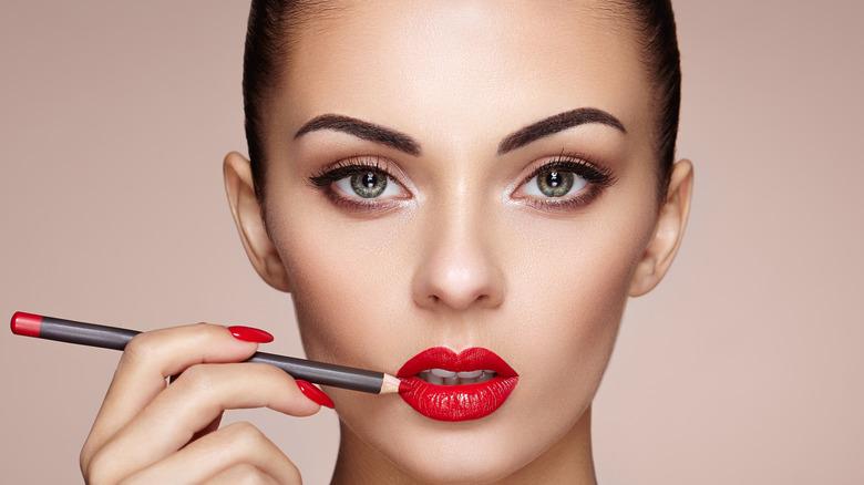 Woman lining lips