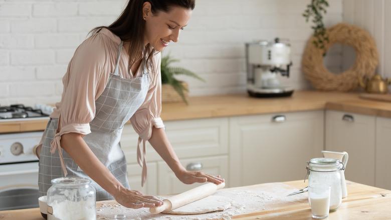 Woman rolling dough