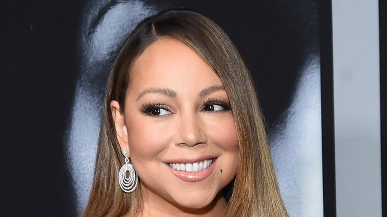 Mariah Carey smiling with diamond earrings
