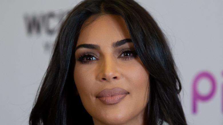 Kim Kardashian listening