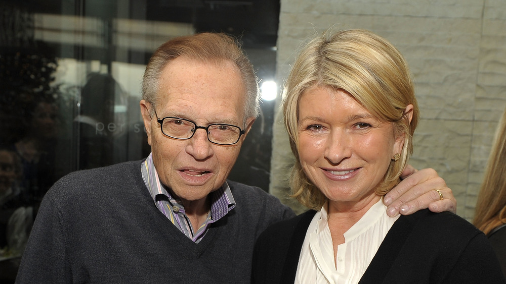 Martha Stewart and Larry King smiling together