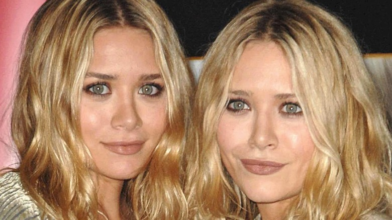 Mary Kate and Ashley Olsen wearing boho outfits on the red carpet