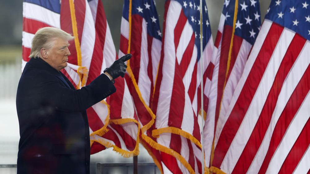 Donald Trump in black coat
