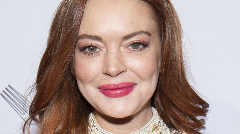 Lindsay Lohan smiles at an event