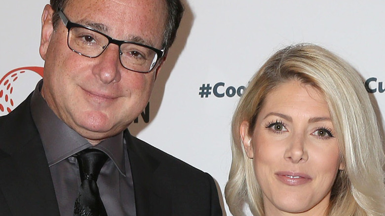 Bob Saget posing with wife Kelly Rizzo