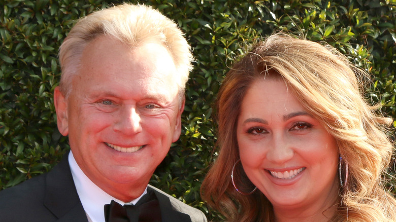 Pat Sajak smiles with Lesly Brown