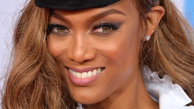 Tyra Banks smiles