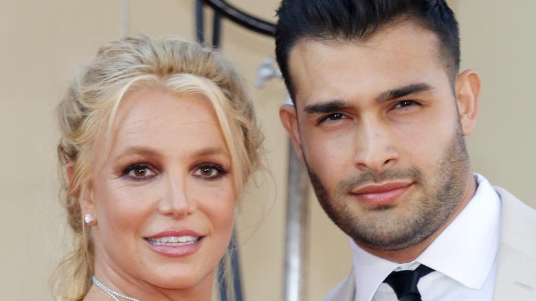 Britney Spears and Sam Asghari posing