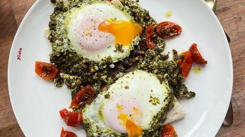 Pesto eggs with runny yolks