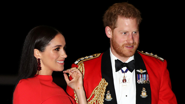 Meghan and Harry in uniform
