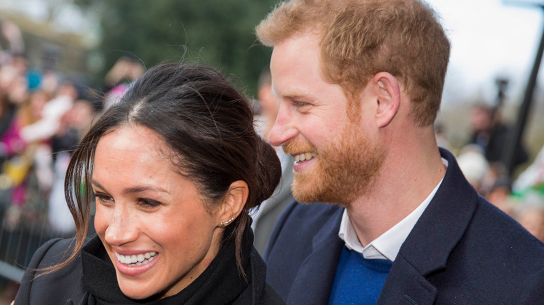 Prince Harry holding Meghan Markle in public