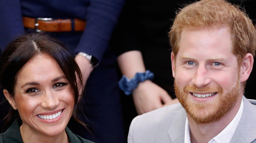 Meghan Markle and Prince Harry pose at an event together