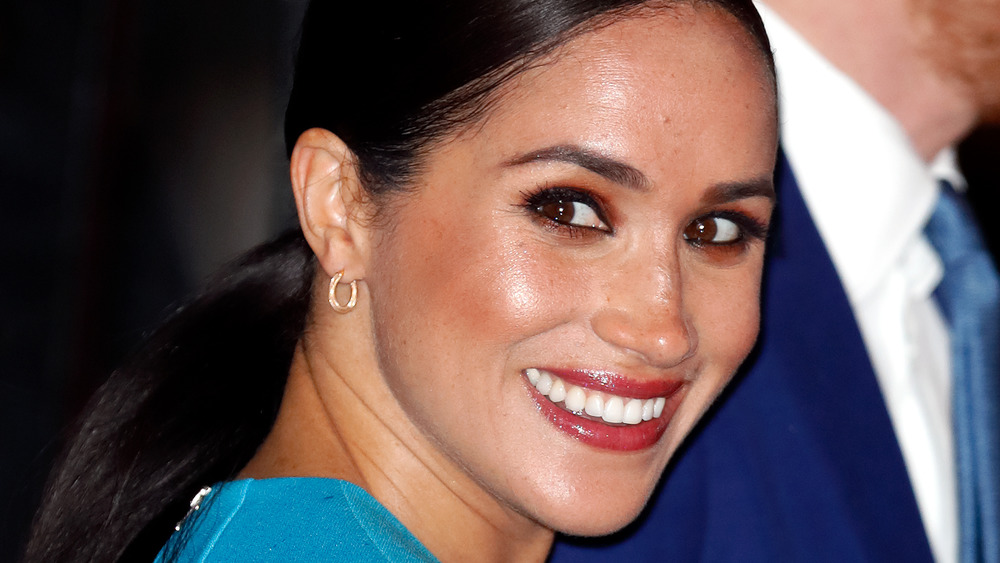 Meghan Markle smiles with Prince Harry