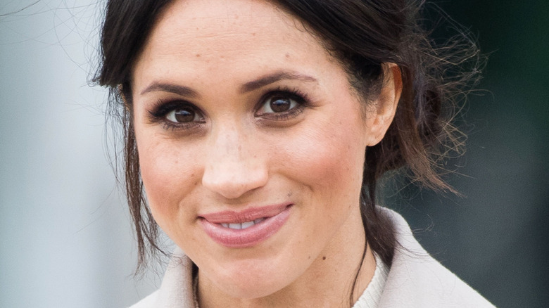 Meghan Markle smiles at an event