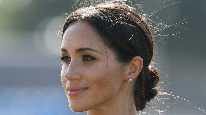 Meghan Markle looks off into the distance