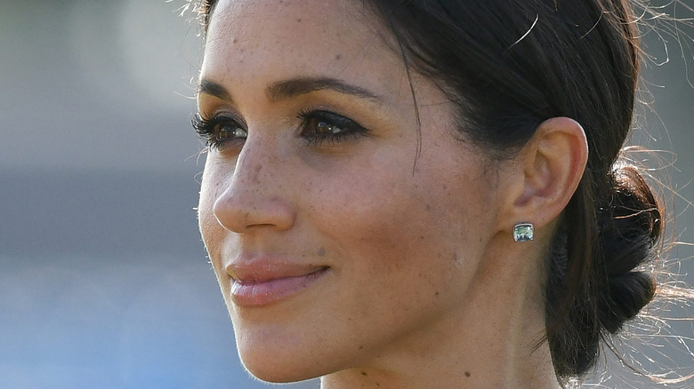 Meghan Markle looks away from camera