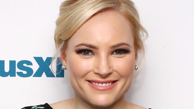 Meghan McCain smiling with silver earrings