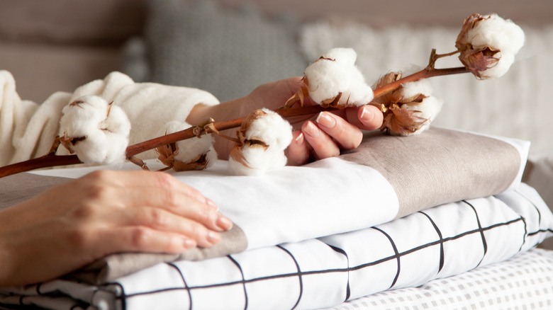 Woman holding cotton over sheets