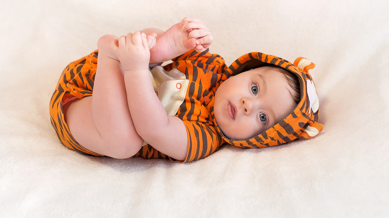 baby wearing tiger outfit