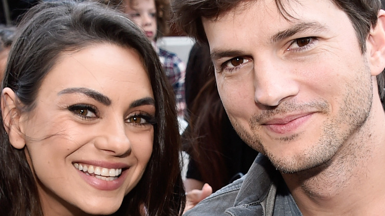 Mila Kunis and Ashton Kutcher smiling together