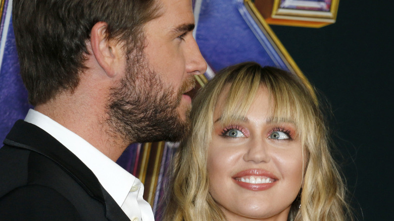 Miley Cyrus looking up at Liam Hemsworth