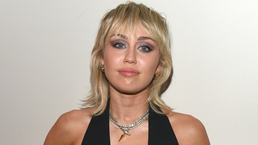 Miley Cyrus wears black dress