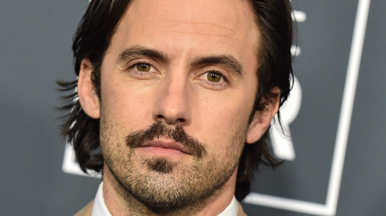 Milo Ventimiglia looking serious with facial hair