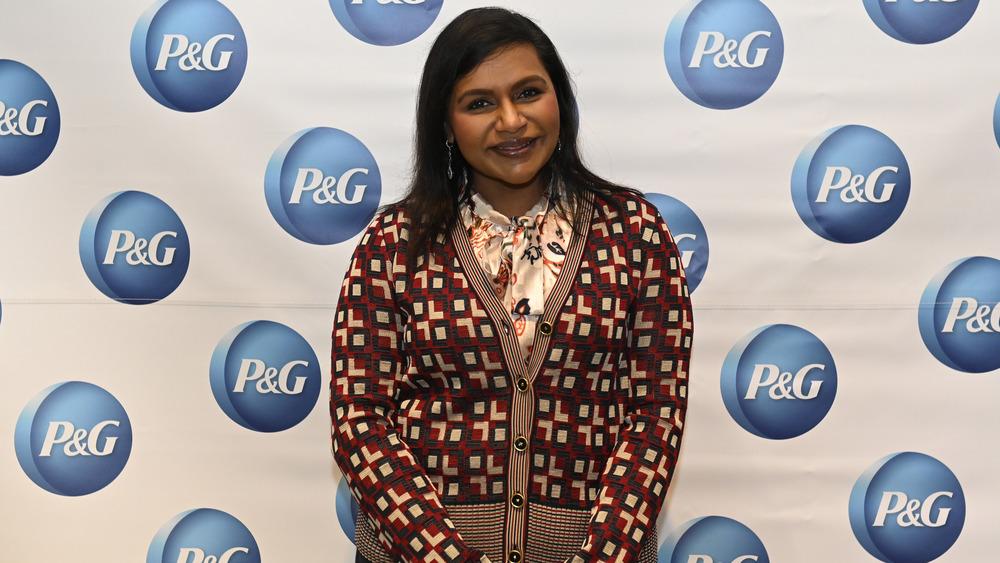 Mindy Kaling smiling in cardigan