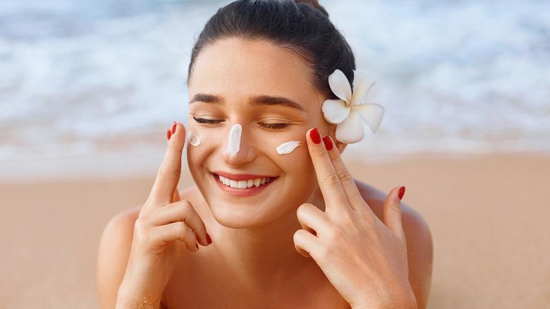 Applying sunscreen at the beach