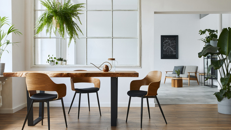 A minimalist house with a wooden dining table and chairs