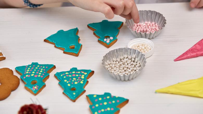 Woman decorating sugar cookies