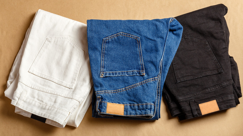 A pile of different-colored jeans