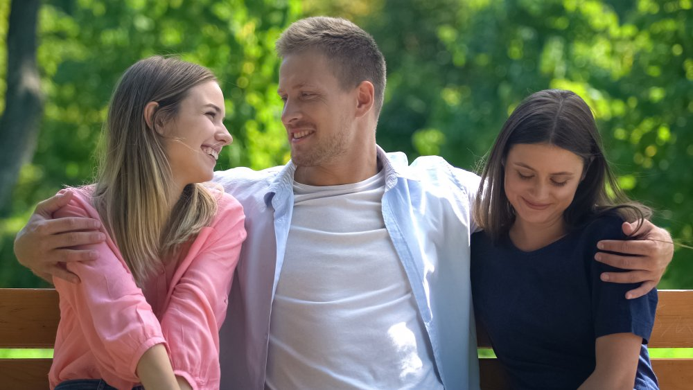 Three people in a polyamorous  relationship