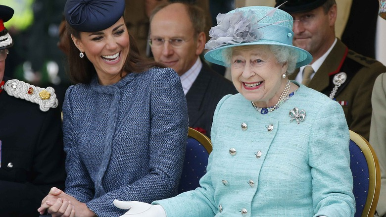 Kate Middleton laughing with Queen Elizabeth