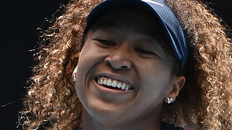 Naomi Osaka smiling on the court