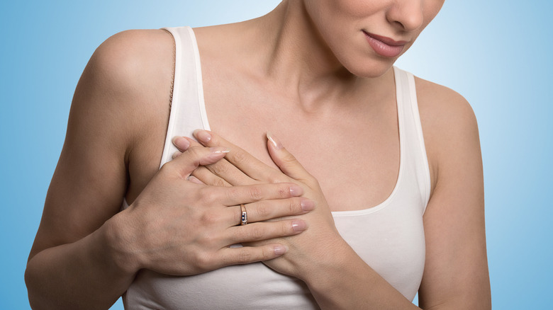 white woman holding breast
