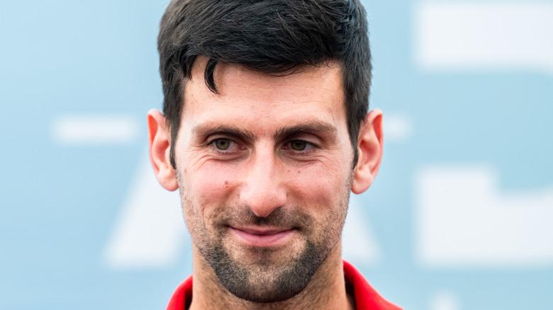 Tennis player Novak Djokovic smiling
