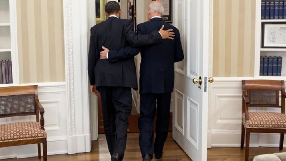 Biden and Obama exiting Oval Office