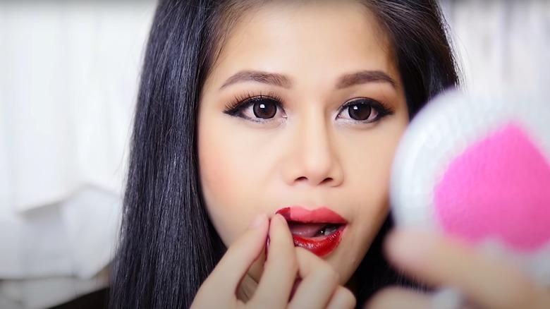 Tina peels off lipstick