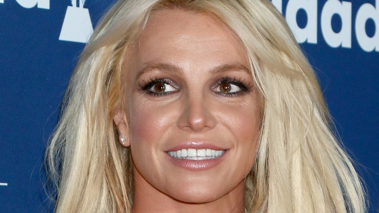 Britney Spears smiling onstage at an event