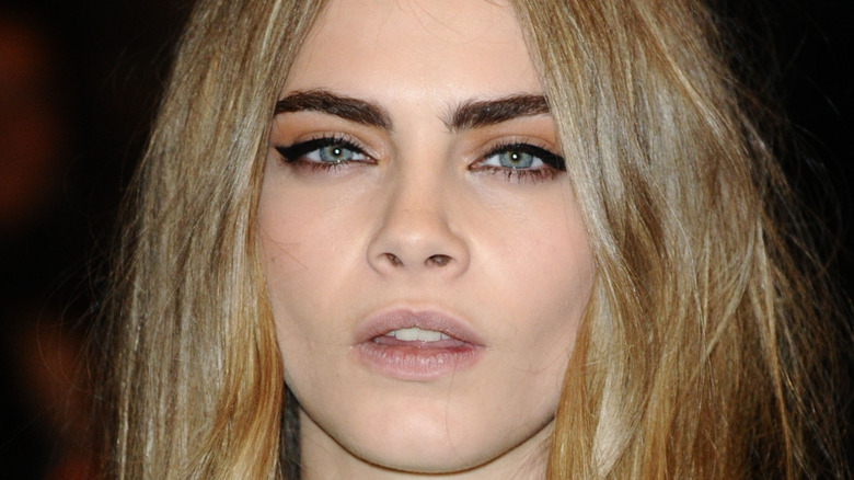Cara Delevingne posing for the camera at an event