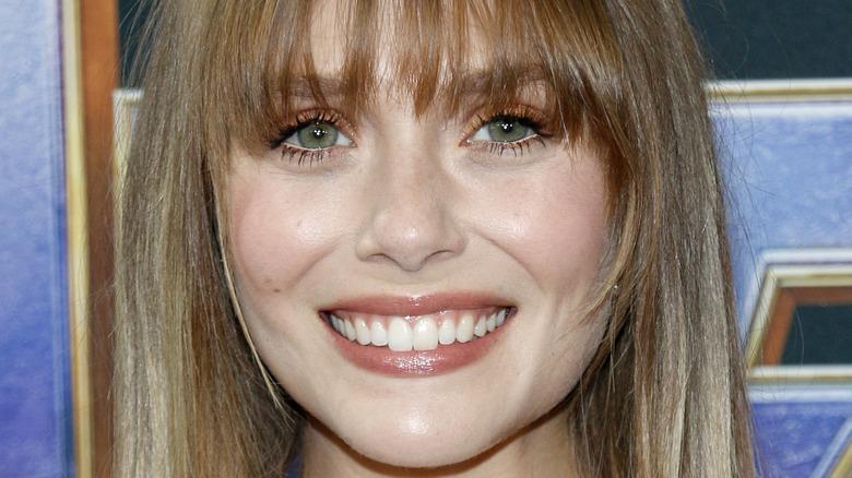 Elizabeth Olsen smiling at a Marvel movie premiere